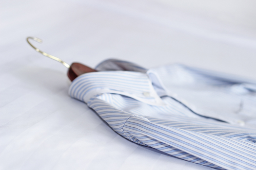 Men's classic shirts on the bed. Shallow depth of field