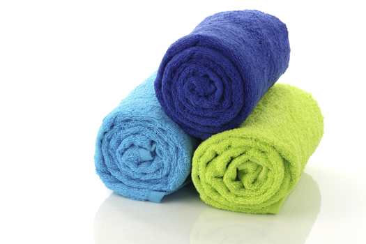 colorful rolled up and stacked bathroom towels